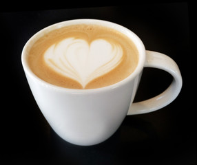 latte art heart on coffee cup