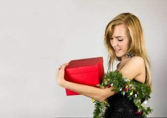 Young pretty woman with Christmas present