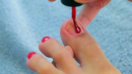 Closeup Red Pedicure. Woman Foot. Nail Polish.