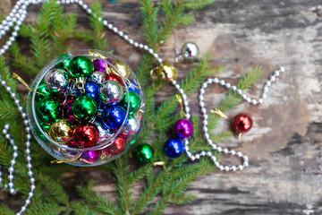 Colorful Christmas balls on wooden background