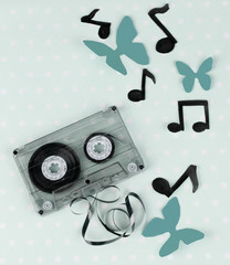Old cassette on blue background