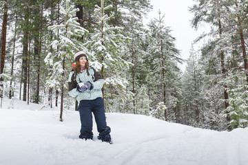 Woman throwing snowball outdoors winter
