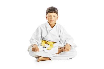 Little karate kid sitting legs crossed
