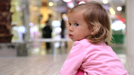 Little girl in a supermarket.