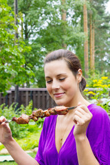 woman enjoying barbecue outdoors