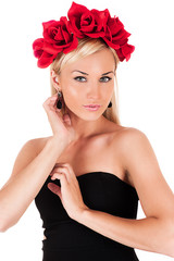 portrait of a beautiful woman with red roses on her head