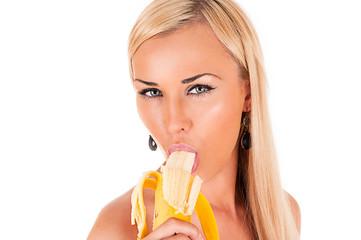 attractive blond woman sexy eats banana