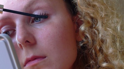 Young Beautiful Girl with Makeup Applying Mascara on Eyes.