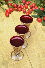 Rosehip fruit and alcoholic liquor in a glasses