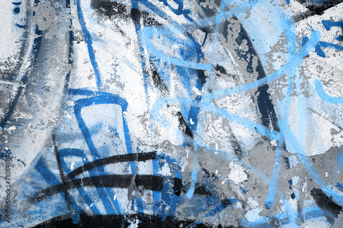 Abstract blue graffiti fragment on gray urban concrete wall - 71084087
