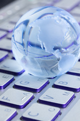 business concept with  globe on laptop keyboard