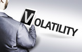Business man with the text Volatility in a concept image poster