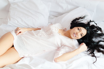 beautiful young woman relaxing in bed