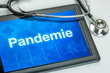 Tablet mit dem Text Pandemie auf dem Display
