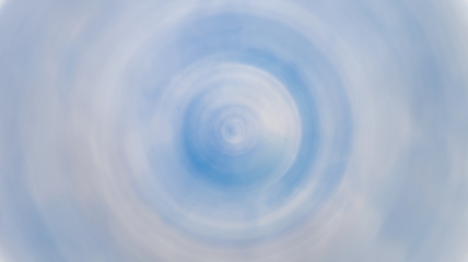 Spin blur cicle of bright blue sky