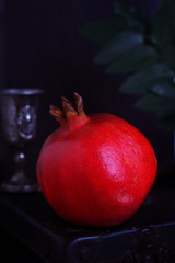 Pomegranate fruit on black rustic background