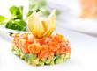 Salmon tartar over white background. Gourmet food