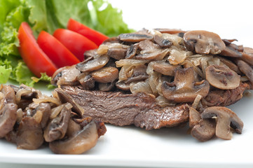 Fried beef with mushrooms and fresh tomatoes