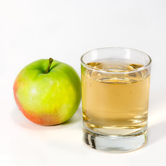 Glass with juice and apple