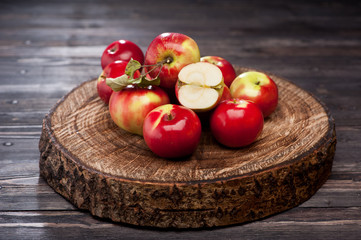 Ripe red apples over wood