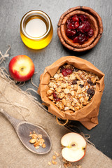 Granola, dried berries, apples and honey. Fitness breakfast