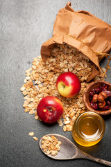 Granola, honey, nuts and fresh apples. Fitness breakfast