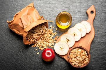 Granola, honey and fresh apples. Fitness breakfast.
