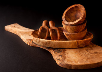 Wooden utensils. Cutting board, bowls and scoop