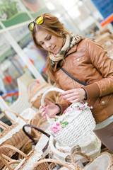woman holding a basket in supermarket