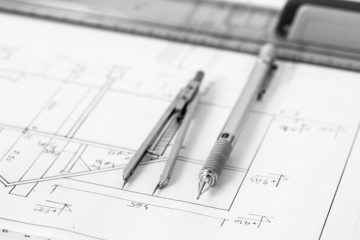 Mechanical pencil and divider on technical drawing