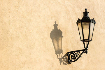 Street lamp with shadow in Prague