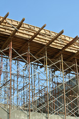 Timber beam formwork supported by row of scaffolding