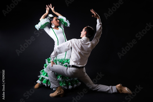 Foto op Canvas Dance School Young flamenco dancers in beautiful dress on black background.