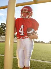Female American Football Player Wearing Helmet