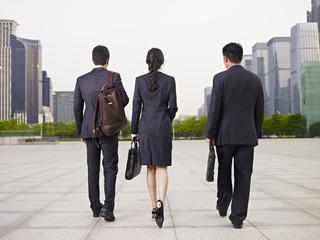 asian business people walking on street