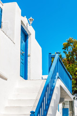 Blue bannister and door of a typical house in Mykonos
