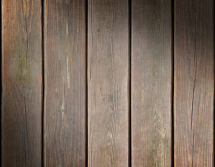 Weathered wooden plank background lit diagonally