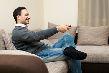 Portrait of a man watching TV