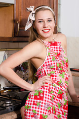 Funny pinup housewife on kitchen