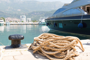 Rope and bollard on pier