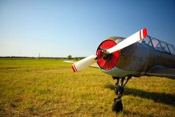 Old russian airplane on green grass