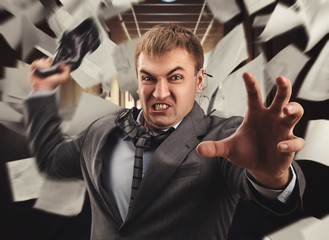 Crazy businessman is fighting in office
