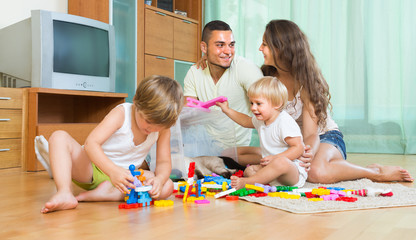 Happy family playing in home interior