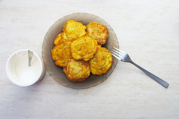 Plate of potato pancakes on the table
