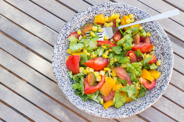 Salad in plate top view