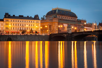 National Theater in Prague during the evening viewed from Vltava