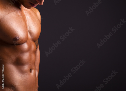 Beautiful man torso on black background - 71097612
