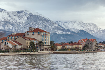 It's snowing in the mountains.  Tivat city, Montenegro