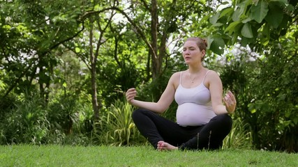 3of10 Relaxed pregnant woman, mom doing yoga