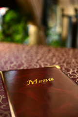 Menu book on table in restaurant